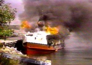 Nawash fishing tug burns in summer of 1995 (screen shot from 5th Estate episode)